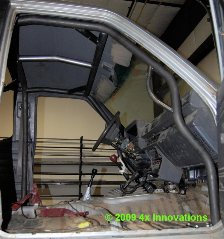 Official in cab cage thread pirate4x4 com 4x4 and off road forum for Interior roll cage for toyota pickup