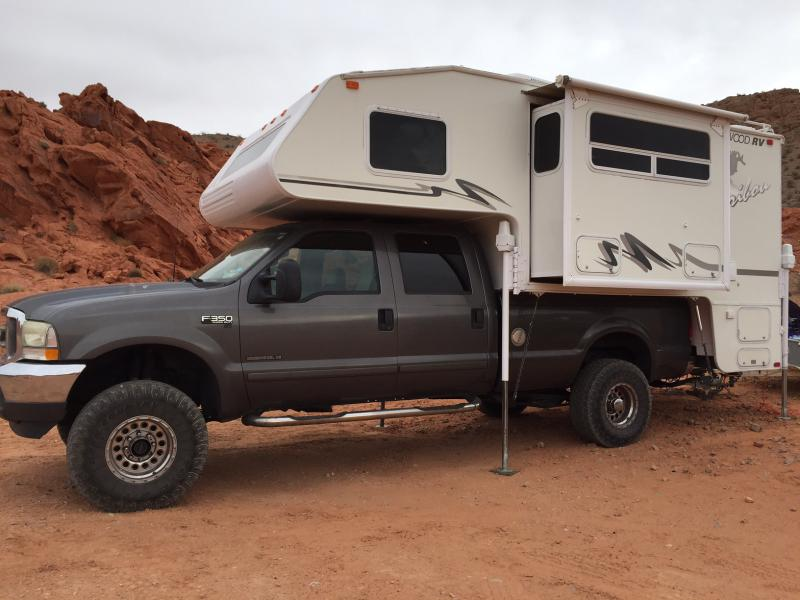 2001 Fleetwood Caribou Model 11-J Cab over truck camper with
