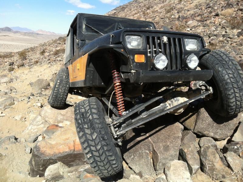 Rock crawling Jeep Wrangler YJ