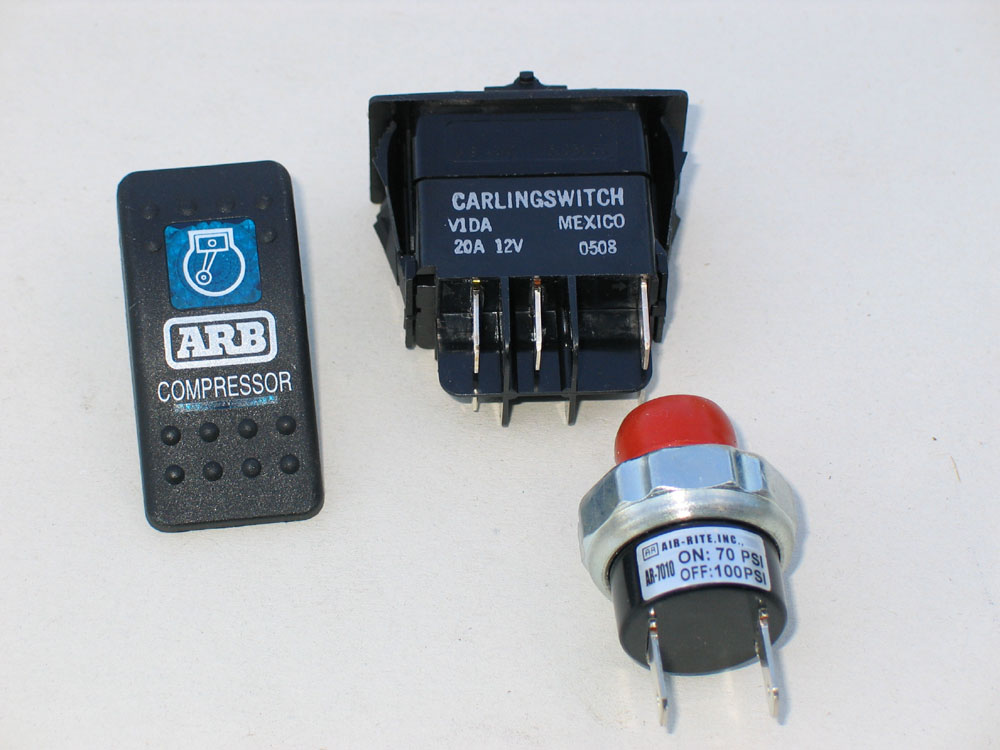 The dash-mounted, compressor activation switch (left) and